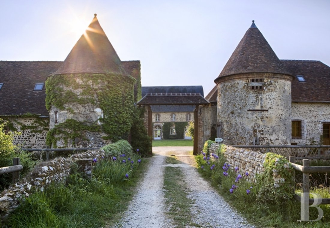 A majestic fortified farm surrounded by water  in the Perche natural park - photo  n°1